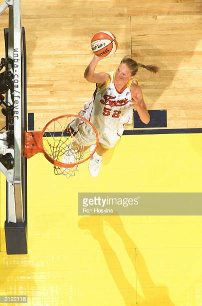Kristen Rasmussen of the Indiana Fever scores against the Seattle Storm on June 28 2003 at Conseco Fieldhouse in Indianapolis Indiana NOTE TO USER...