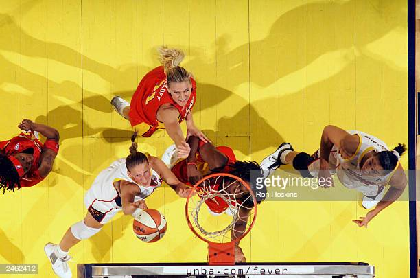 Kristen Rasmussen of the Indiana Fever shoots a layup past Taj McWilliamsFranklin of the Connecticut Sun during the game at Conseco Fieldhouse on...