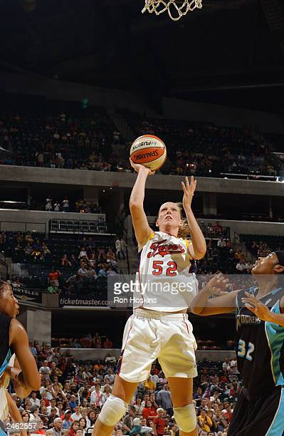 Kristen Rasmussen of the Indiana Fever shoots over LaToya Thomas of the Cleveland Rockers during the game at Conseco Fieldhouse on August 23 2003 in...