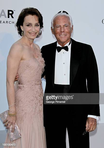 Kristen Scott Thomas and Giorgio Armani attend amfAR's Cinema Against AIDS Gala at the Hotel Du Cap during the 63rd International Cannes Film...