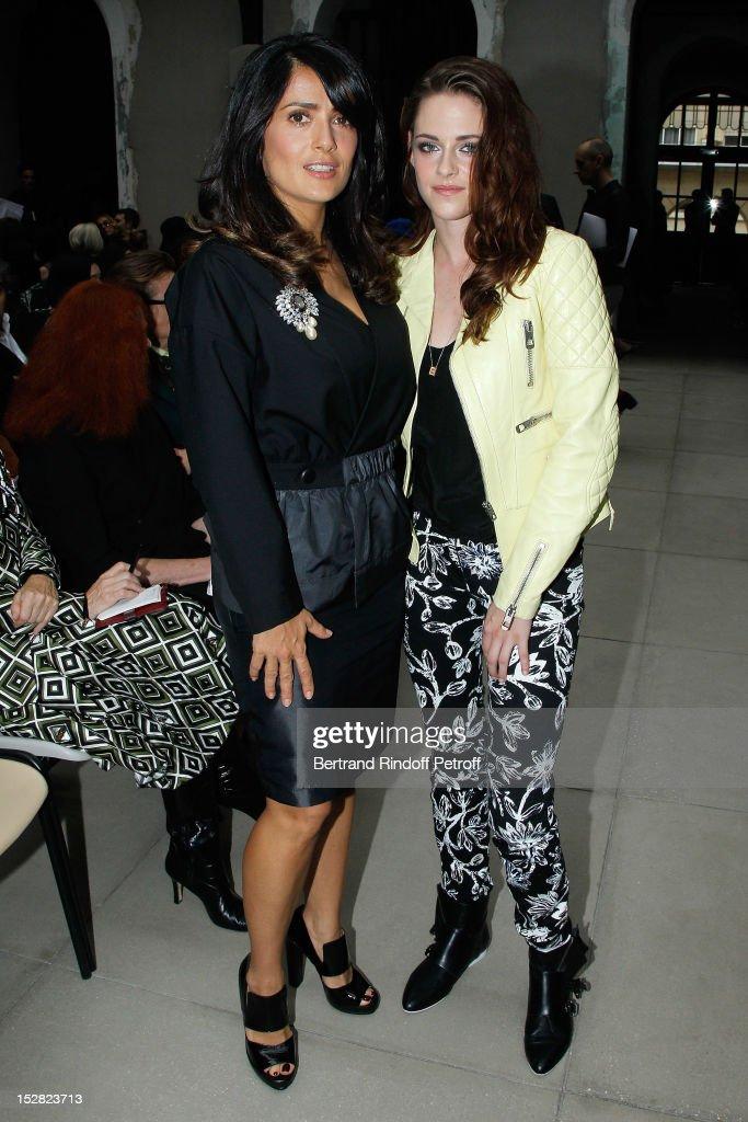 Kristen Stewart and Salma Hayek attend the Balenciaga Spring / Summer 2013 show as part of Paris Fashion Week on September 27, 2012 in Paris, France.