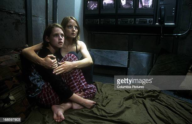 Kristen Stewart is held by Jodie Foster in a scene from the film 'Panic Room', 2002.