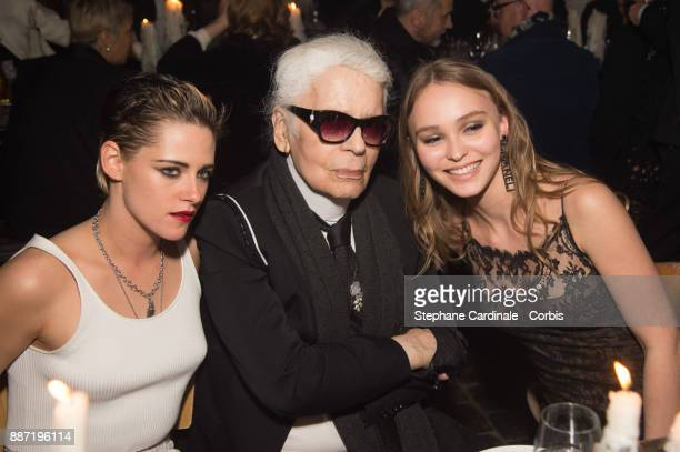 Kristen Stewart Karl Lagerfeld and Lily Rose Depp attend the Chanel Collection Metiers d'Art Paris Hamburg 2017/18 Party on December 6 2017 in...