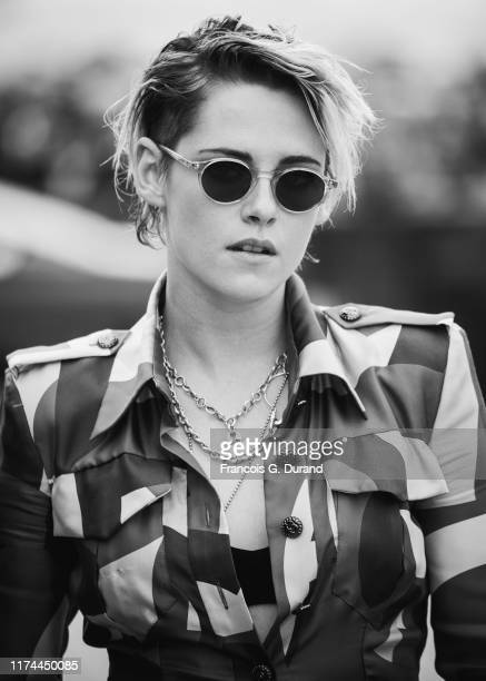 Kristen Stewart poses for the photographers after she unveiled her cabin sign given in tribute to her career along the Promenade des Planches during...