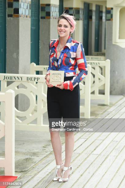 Kristen Stewart poses next to the beach closet dedicated to her during the Kristen Stewart photocall during the 45th Deauville American Film Festival...