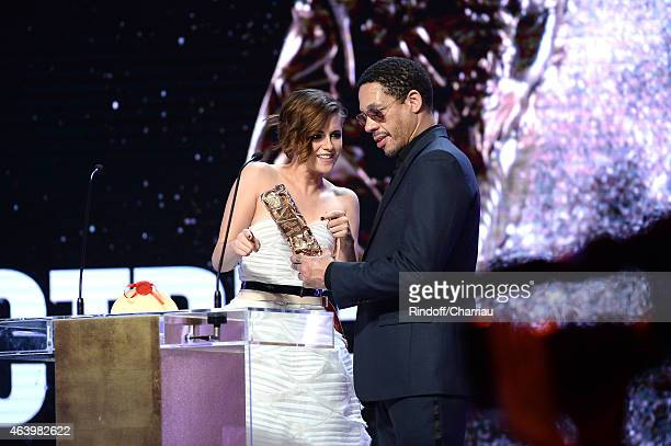 Kristen Stewart receives from JoeyStarr the award for Best Actress in a Supporting Role in 'Sils Maria' during the 40th Cesar Film Awards 2015...
