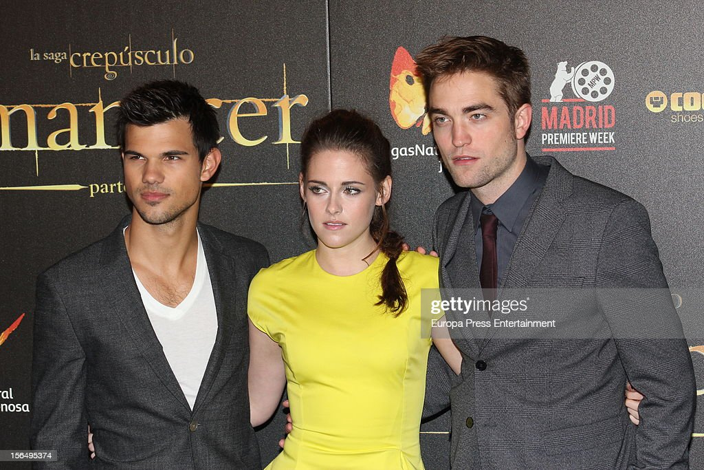 Kristen Stewart, Robert Pattinson (R) and Taylor Lautner attend 'The Twilight Saga: Breaking Dawn - Part 2' photocall at Kinepolis Cinema on November 15, 2012 in Madrid, Spain.