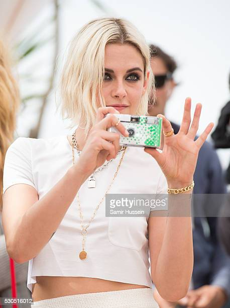 Kristen Stewart takes a photo as she attends the 'Cafe Society' photocall during the 69th annual Cannes Film Festival at Palais des Festivals on May...