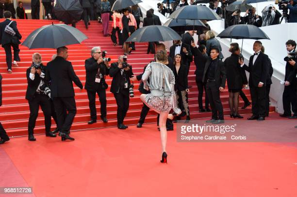 """Kristen Stewart takes off her shoes at the screening of """"BlacKkKlansman"""" during the 71st annual Cannes Film Festival at Palais des Festivals on May..."""