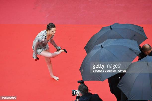 Kristen Stewart takes off her shoes at the screening of BlacKkKlansman during the 71st annual Cannes Film Festival at Palais des Festivals on May 14...