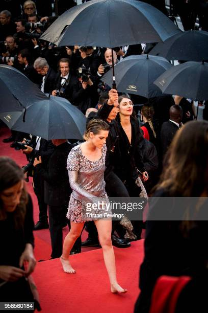 Kristen Stewart walks with bare feet at the screening of 'BlacKkKlansman' during the 71st annual Cannes Film Festival at Palais des Festivals on May...