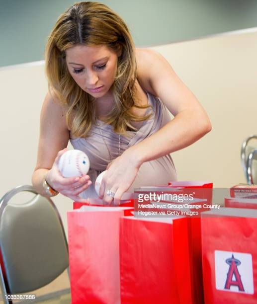 Kristen Weaver wife of Angel pitcher Jered Weaver packs bags with signed baseballs for a charity fundraiser on Saturday June 21 to raise money for...