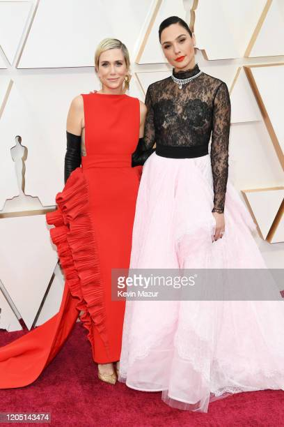 """Kristen Wiig and Gal Gadot of """"Wonder Woman 1984"""" attend the 92nd Annual Academy Awards at Hollywood and Highland on February 09, 2020 in Hollywood,..."""
