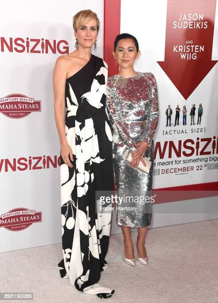 Kristen Wiig and Hong Chau attend the Los Angeles Special Screening of 'Downsizing' at The Regency Village Theatre onDecember 18 2017 in Westwood CA