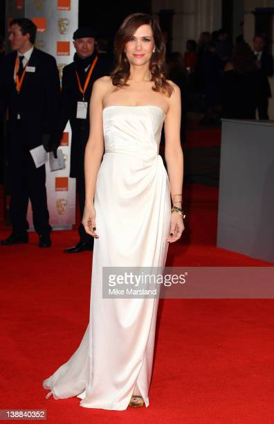 Kristen Wiig arrives at the Orange British Academy Film Awards at The Royal Opera House on February 12 2012 in London England