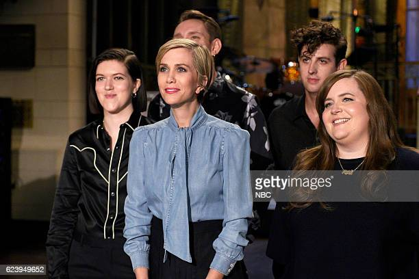 LIVE 'Kristen Wiig' Episode 1711 Pictured Romy Madley Croft Oliver Sim and Jamie xx of musical guest The xx pose with host Kristen Wiig and Aidy...