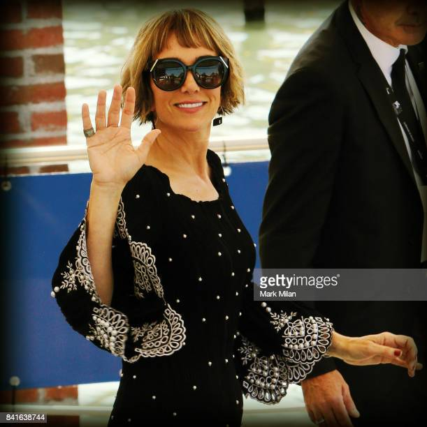 Kristen Wiig waves while bording her water taxi during the 74th Venice Film Festival on August 30 2017 in Venice Italy