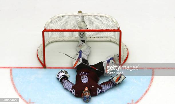Kristers Gudlevskis goaltender of Latvia lies dejected on the ice after losing against Canada during extra time during the 2018 IIHF Ice Hockey World...