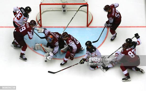Kristers Gudlevskis goaltender of Latvia tends net against Canada during the 2018 IIHF Ice Hockey World Championship Group B game between Canada and...