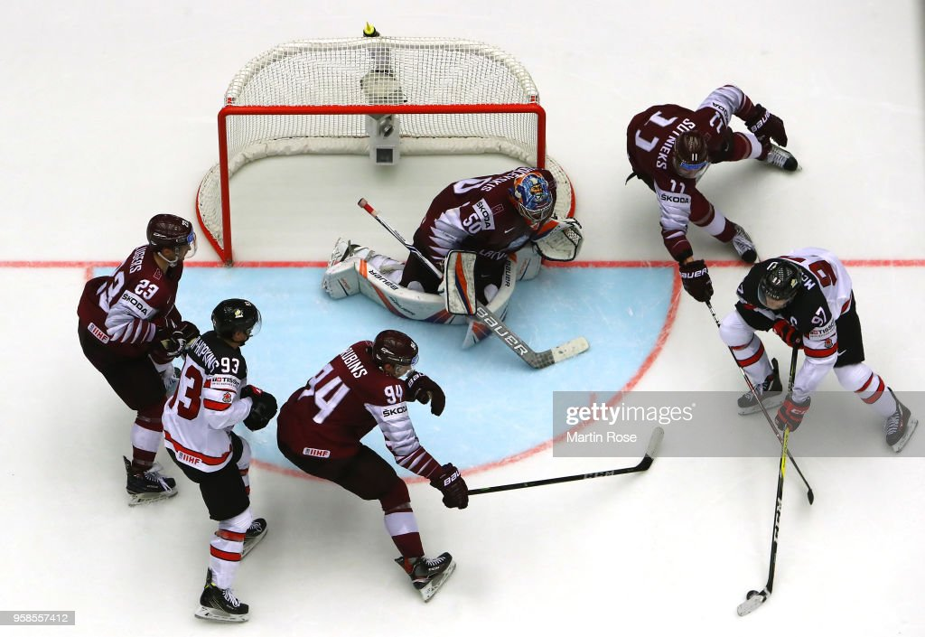 Kristers Gudlevskis, goaltender of Latvia tends net against Connor McDavid #97 of Canada during the 2018 IIHF Ice Hockey World Championship Group B game between Canada and Latvia at Jyske Bank Boxen on May 14, 2018 in Herning, Denmark.