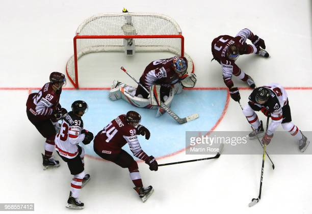 Kristers Gudlevskis goaltender of Latvia tends net against Connor McDavid of Canada during the 2018 IIHF Ice Hockey World Championship Group B game...