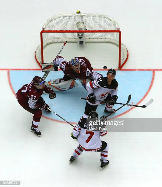 Kristers Gudlevskis goaltender of Latvia tends net against Tyson Jost of Canada during the 2018 IIHF Ice Hockey World Championship Group B game...