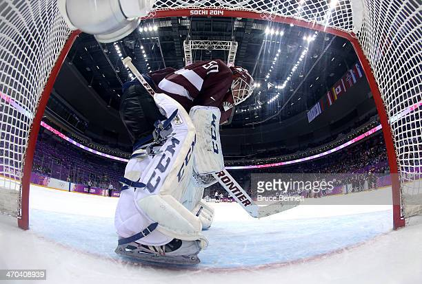 Kristers Gudlevskis of Latvia looks on in the third period against Canada during the Men's Ice Hockey Quarterfinal Playoff on Day 12 of the 2014...