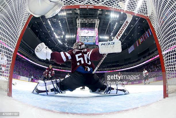 Kristers Gudlevskis of Latvia makes a save during the Men's Ice Hockey Quarterfinal Playoff on Day 12 of the 2014 Sochi Winter Olympics at Bolshoy...