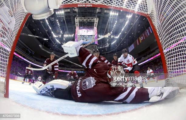 Kristers Gudlevskis of Latvia makes a save during the third period of the Men's Ice Hockey Quarterfinal Playoff on Day 12 of the 2014 Sochi Winter...