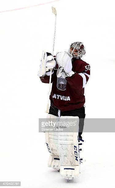 Kristers Gudlevskis of Latvia reacts after losing 21 to Canada during the Men's Ice Hockey Quarterfinal Playoff on Day 12 of the 2014 Sochi Winter...