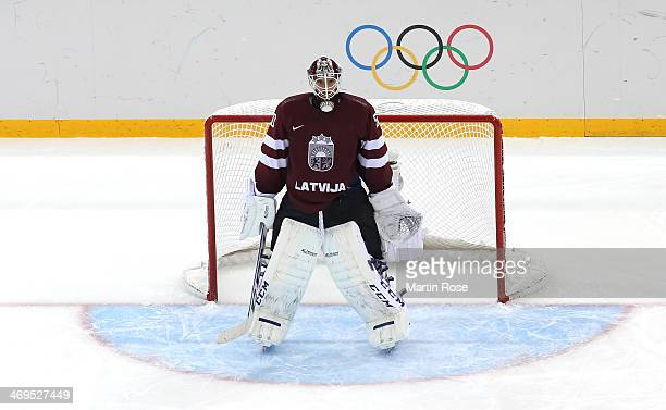 Kristers Gudlevskis of Latvia waits in his net against Sweden during the Men's Ice Hockey Preliminary Round Group C game on day eight of the Sochi...