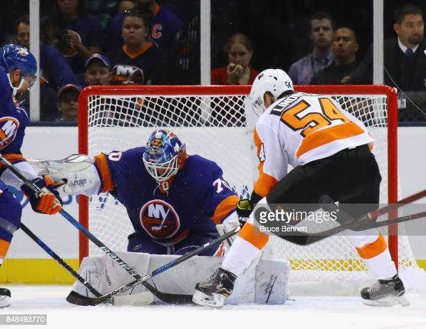 Kristers Gudlevskis of the New York Islanders makes the first period save on Oskar Lindblom of the Philadelphia Flyers during a preseason game at the...