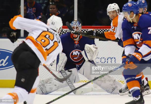 Kristers Gudlevskis of the New York Islanders waits for a shot from Philippe Myers of the Philadelphia Flyers during the first period during a...