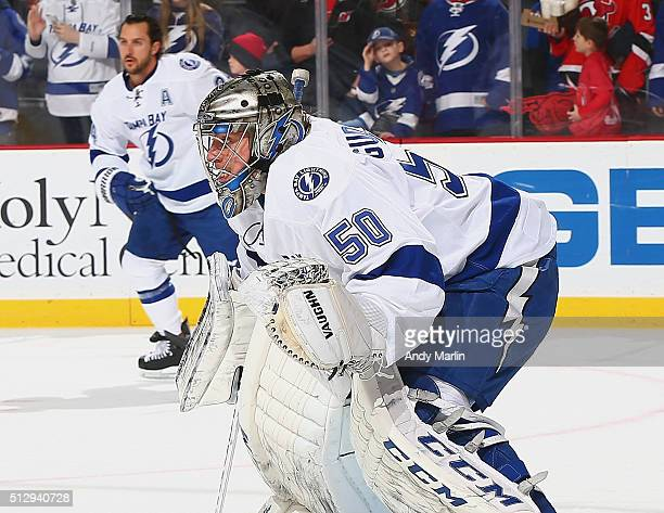 Kristers Gudlevskis of the Tampa Bay Lightning defends his net during pregame warmups prior to the game agaiinst the New Jersey Devils at the...