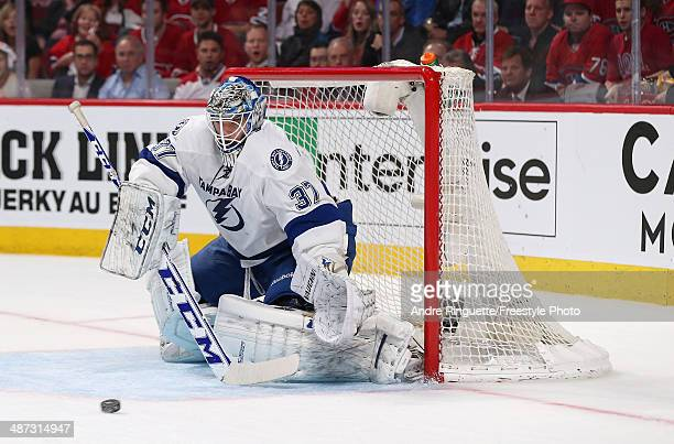 Kristers Gudlevskis of the Tampa Bay Lightning guards his net against the Montreal Canadiens in Game Four of the First Round of the 2014 NHL Stanley...