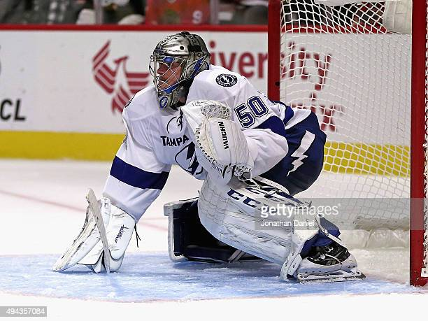 Kristers Gudlevskis of the Tampa Bay Lightning guards the goal against the Chicago Blackhawks at the United Center on October 24 2015 in Chicago...