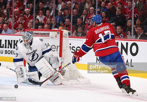 Kristers Gudlevskis of the Tampa Bay Lightning makes a save against Rene Bourque of the Montreal Canadiens in Game Four of the First Round of the...