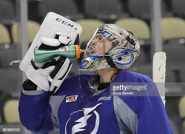 Kristers Gudlevskis of the Tampa Bay Lightning takes a water break during an offday practice session prior to Game Two of the Eastern Conference...