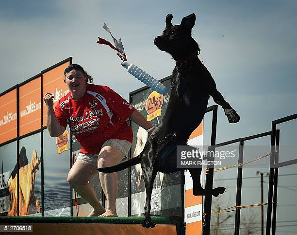 Kristi Baird watches as her dog 'Tianna' leaps into the water to record the distance of her jump during the Dock Dogs West Coast Challenge in...