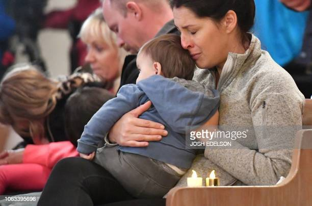 Kristi Collins mourns with her son Andrew 9 months during a vigil for victims of the Camp fire at First Christian Church in Chico California on...
