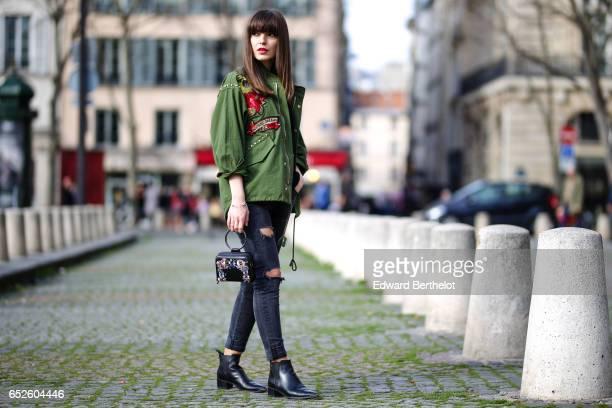 Kristi Gogsadze fashion blogger La Georgienne wears Zara black denim jeans cropped and ripped trousers a Zara black top a Zara green bomber jacket...