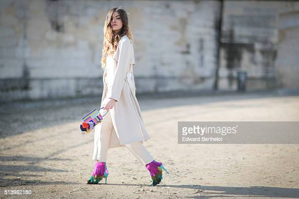 Kristi Gogsadze is wearing a Tara Jarmon outfit a Tonya Hawkes clutch and Maison Ernest shoes after the Elie Saab show during Paris Fashion Week...