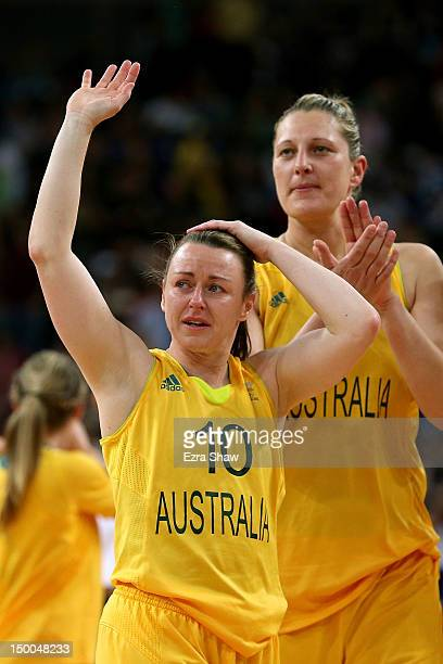 Kristi Harrower of Australia and Suzy Batkovic of Australia wave to the crowd after being defeated 8673 by United States in the Women's Basketball...
