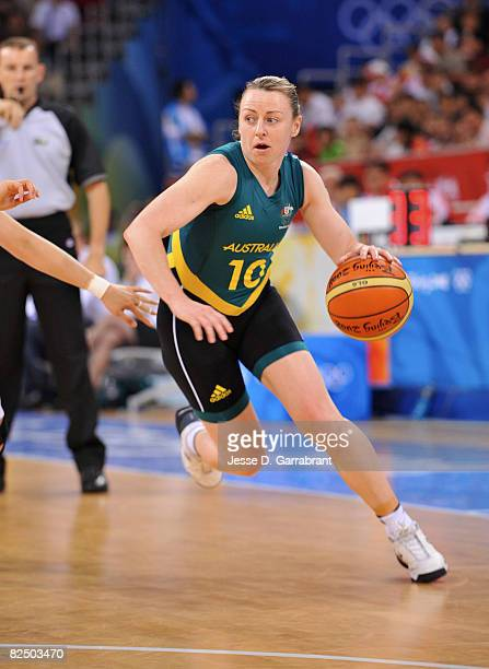 Kristi Harrower of Australia drives against China during the Women's Semifinals basketball game at the Wukesong Indoor Stadium during Day 13 of the...