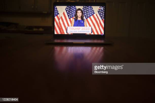 Kristi Noem, governor of South Dakota, speaks during the Republican National Convention seen on a laptop computer in Tiskilwa, Illinois, U.S., on...
