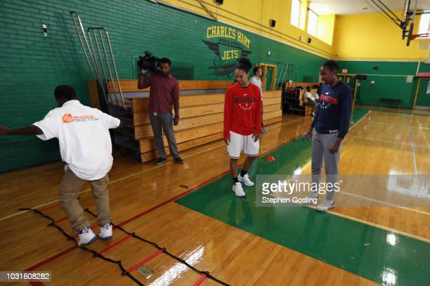 Kristi Toliver and Ariel Atkins the Washington Mystics look on during the 2018 Jr WNBA Clinic on September 11 2018 at Hart Middle School in...