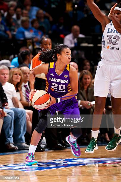 Kristi Toliver of the Los Angeles Sparks looks to pass the ball against Rebekkah Brunson of the Minnesota Lynx during Game One of the 2012 WNBA...