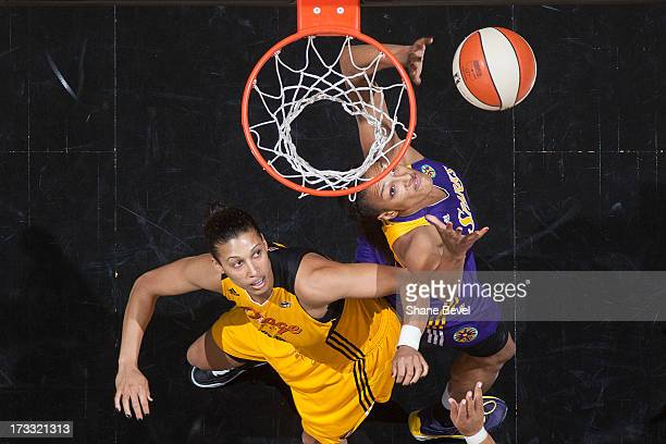 Kristi Toliver of the Los Angeles Sparks reaches for a rebound against Nicole Powell of the Tulsa Shock during the WNBA game on July 11 2013 at the...