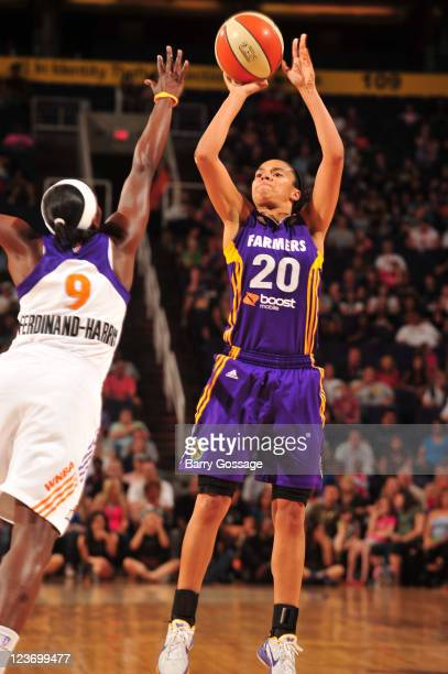 Kristi Toliver of the Los Angeles Sparks shoots against Marie FerdinandHarris of the Phoenix Mercury on September 3 2011 at US Airways Center in...