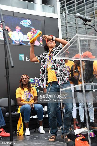 Kristi Toliver of the Los Angeles Sparks throws shoes to the fans during the Championship Rally at LA LIVE on October 24 2016 in Los Angeles...